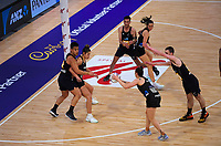 Whitney Souness looks to pass to Maia Wilson during the Cadbury Netball Series final between NZ Silver Ferns and NZ Men at the Fly Palmy Arena in Palmerston North, New Zealand on Saturday, 24 October 2020. Photo: Dave Lintott / lintottphoto.co.nz