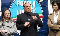 Il leader del Popolo della Liberta' Silvio Berlusconi, al centro, affiancato dalle deputate Giorgia Meloni, sinistra, e Mara Carfagna, presenta il Camper della Liberta' in Piazza del Popolo, Roma, 12 marzo 2008..Leader of the People of Freedom's center-right coalition Silvio Berlusconi, center, flanked by lawmakers Giorgia Meloni, left, and Mara Carfagna, presents the Camper of Freedom in Rome's Piazza del Popolo, 12 march 2008..UPDATE IMAGES PRESS/Riccardo De Luca