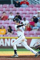 Brandon Bednar #12 of the Salem-Keizer Volcanoes bats against the Tri-City Dust Devils at Volcanoes Stadium on July 27, 2013 in Keizer, Oregon. Tri-City defeated Salem-Keizer, 5-4. (Larry Goren/Four Seam Images)