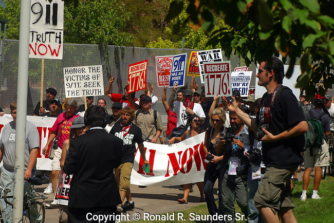 ANTI-PROTESTORS MARCH in the STREETS  of DENVER DURING the DEMOCRATIC CONVENTION in 2008 WHILE PHOTOGRAPHERS and the PRESS LOOK ON