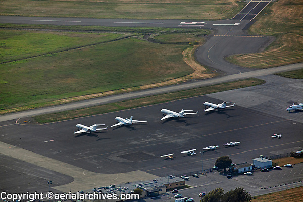 aerial photograph of aircraft parked at the Napa County Airport (APC), Napa, California, runway 19L in the background