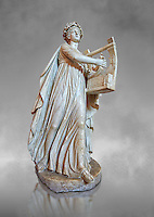 Roman ststue of Apollo with a lyre, copied from an earlier 4th cebtury BC Hellenistic statue, from a group of Muses found in Villa de Cassius at Tivoli,  inv 310, Vatican Museum Rome, Italy,  grey art background