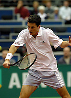 Henman in his match against Ljubicic