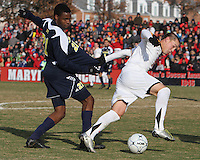 Casey Townsend #11of the University of Maryland grabs hold of Latif Alashe #21 of the University of Michigan during an NCAA quarter-final match at Ludwig Field, University of Maryland, College Park, Maryland on December 4 2010.Michigan won 3-2 AET.