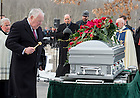 Mar. 4, 2015; Jim Hesburgh sprinkles holy water on the casket of President Emeritus Rev. Theodore M. Hesburgh at the graveside service at the Congregation of Holy Cross Cemetery. (Photo by Barbara Johnston/University of Notre Dame)