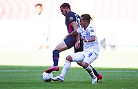 GUADALAJARA, MEXICO - MARCH 28: Hassani Dotson #18 of the United States battles with Edwin Rodriguez #8 of Honduras during a game between Honduras and USMNT U-23 at Estadio Jalisco on March 28, 2021 in Guadalajara, Mexico.