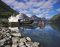 Cross-fjord ferry sits at the pier at Fjaerland in Fjaerlandfjord in the Sogn district, Norwa