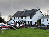 Pictured: at the King Arthur restaurant, in Reynoldston, Wales, UK.<br /> Re: A restaurant has stuck pictures of Wales' First Minister Mark Drakeford on its pumps at the bar and on a dart board, after recent changes to Covid-19 regulations, banned the serving of alcohol and all hospitality businesses closing at 6pm.<br /> The pictures at the King Arthur restaurant in Reynoldston in the Gower Peninsula, show the Welsh politician sipping water from a glass wearing a Santa hat which has been superimposed.