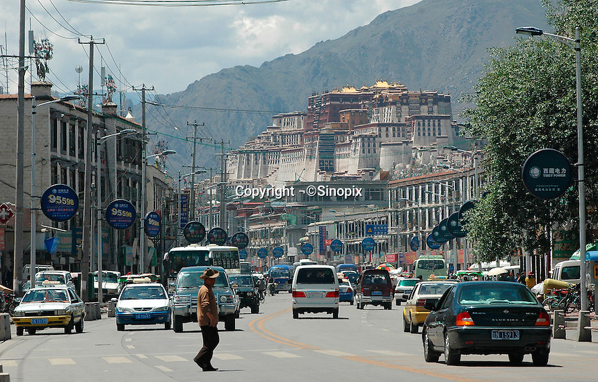 The Potala palace as seen from Beijing Lu in Lhasa, Tibet. The number of tourists allowed to enter the palace is strictly regulated to 2,300 each day and the entrance fee for tourists has increased to 300 RMB, a large amount in China. .27 Jul 2006.