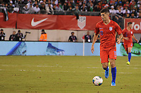EAST RUTHERFORD, NJ - SEPTEMBER 6: Christian Pulisic #10 of the United States kicks the ball during a game between Mexico and USMNT at MetLife Stadium on September 6, 2019 in East Rutherford, New Jersey.