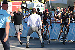 TOUR DE FRANCE 2020- UCI Cycling World Tour under Virus Outbreak. Stage 18th from Meribel to La Roche-Sur-Foron on the 17th of September 2020, La Roche-Sur-Foron, France. A staff member runs to block a fan who jumped over the barriers as Team Ineos rider Poland's Michal Kwiatkowski (R) rides to cross the finish line ahead of Team Ineos rider Ecuador's Richard Carapaz during the 18th stage of the 107th edition of the Tour de France cycling race