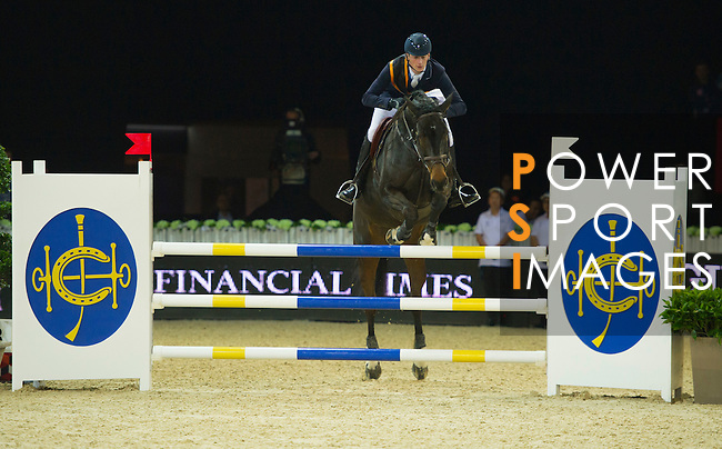The winner Danier Deusser jump over HKJC fence during the HKJC Race of the Rider during the Longines Masters of Hong Kong on 19 February 2016 at the Asia World Expo in Hong Kong, China.  Photo by Juan Manuel Serrano / Power Sport Images