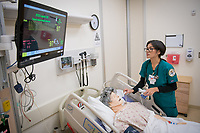 UAA School of Nursing student Phoebe Sayasane monitors her patient's vital signs during a simulated patient care scenario in UAA's Health Sciences Building Simulation Center.
