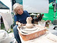 Teresa Griffith, of West Fork, demonstrates making a vase on a potters wheel Sunday Sept. 12, 2021 during West Fest in West Fork. Griffith sells her work through her studio, Griffith Pottery Works. The annual event featured a parade, local vendors, live music, crafts and a raffle to benefit Shop with a Cop and Meals on Wheels. Visit nwaonline.com/210000913Daily/  (NWA Democrat-Gazette/J.T. Wampler)