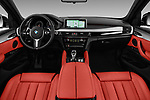 Stock photo of straight dashboard view of 2017 BMW X6 M-sportpakket 5 Door SUV Dashboard
