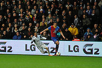 Swansea city's  Jonathan de Guzman is fouled by Scott Dann of Palace. Barclays Premier league, Swansea city v Crystal Palace match at the Liberty Stadium in Swansea, South Wales on Sunday 2nd March 2014.