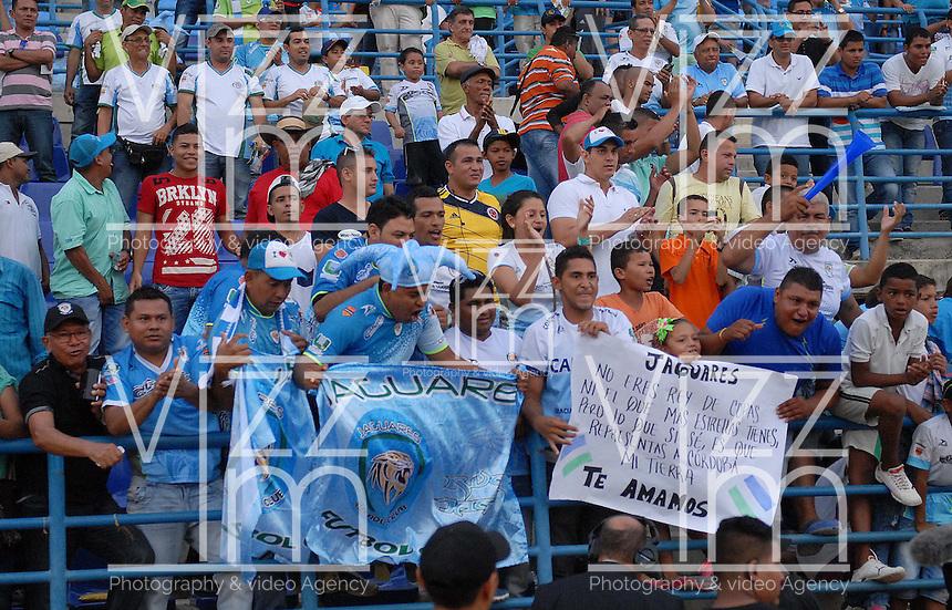 MONTERIA - COLOMBIA - 15-03-2015: Seguidores de Jaguares FC festejan la victoria de su equipo durante partido entre Jaguares FC y Envigado FC por la fecha 10 de la Liga Aguila I 2015, jugado en el estadio Municipal de Monteria. / Supporters of Jaguares FC celebrate the victory of their team during a match between Jaguares FC and Envigado FC for the  date 10 of the Liga Aguila I-2015 at the Municipal de Monteria Stadium in Monteria city, Photo: VizzorImage / Jose Perdomo / Cont.
