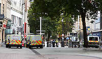 Pictured: The crime scene in Cardiff city centre, Wales, UK. Wednesday 28 September 2016<br /> Re: A 20-year-old man has been arrested after two people were found dead on a main street in Cardiff.<br /> The bodies of a man and a woman were discovered on Queen Street at about 5.50am on Wednesday.<br /> South Wales Police said a man from Newport was in custody in connection with their deaths and officers were not looking for anyone else.<br /> The pedestrianised area from the Aneurin Bevan statue to Churchill Way remains closed.<br /> Police activity appears to be focused outside Boots on the busy shopping street.<br /> St David's shopping centre, which partially adjoins Queen Street, is open to shoppers but the entrance to Boots inside has been closed.
