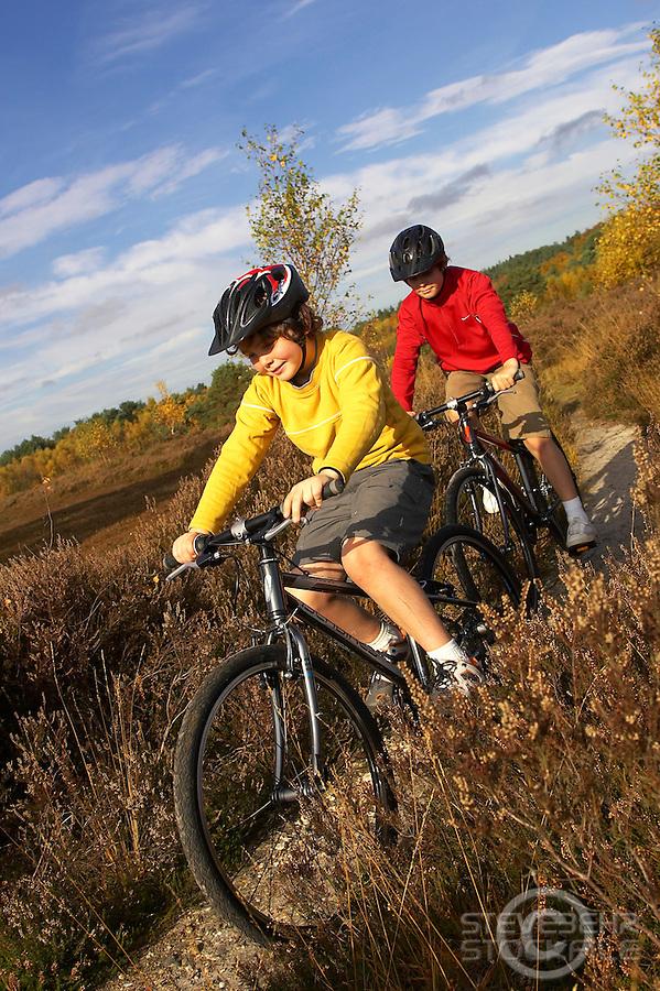 Sam and Josh  riding Islabikes Benin bikes..Wentworth , Surrey     October 2007..
