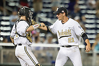 Vanderbilt Commodores pitcher John Kilichowski (21) celebrates with catcher Jason Delay (5) after defeating the TCU Horned Frogs in Game 12 of the NCAA College World Series on June 19, 2015 at TD Ameritrade Park in Omaha, Nebraska. The Commodores defeated TCU 7-1. (Andrew Woolley/Four Seam Images)