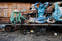 A dismantled carnival float with damaged statues abandoned on the work yard behind the Samba school workshops in Rio de Janeiro, Brazil, 15 February 2012. Most of the large carnival floats, colorful designs and fancy costumes are dismantled, cut into pieces or simply thrown into garbage right after the last day of the Carnival. The low-tech materials as fiberglass, plastic or polystyrene, which most of the of the carnival floats and statues are made of, are stocked in the warehouses to be recycled and used in the future parades. However, there is no use for some of the statues so they slowly fall apart into pieces forming a ?Carnival cemetery? in the industrial yards around the port of Rio de Janeiro.