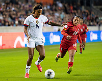 HOUSTON, TX - JANUARY 31: Jessica McDonald #14 of the USA and Maryorie Perez #14 of Panama contest the ball during a game between Panama and USWNT at BBVA Stadium on January 31, 2020 in Houston, Texas.