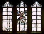 "East Liberty section of Pittsburgh PA:  View of a stained glass window in the Church's Session Room. This image is included in the book; ""The Art and Architecture of the East Liberty Presbyterian Church"".  This window was created in the studios of Henry Lee Willett of Philadelphia.  The theme of the various windows deals with religion at home."