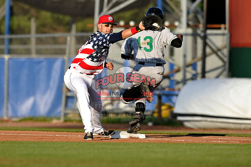 Eric Aguilera #29 takes the throw at first base against the Clinton LumberKings at Community Field  on July 3, 2014 in Burlington, Iowa. The LumberKings beat the Bees 6-5.   (Dennis Hubbard/Four Seam Images)