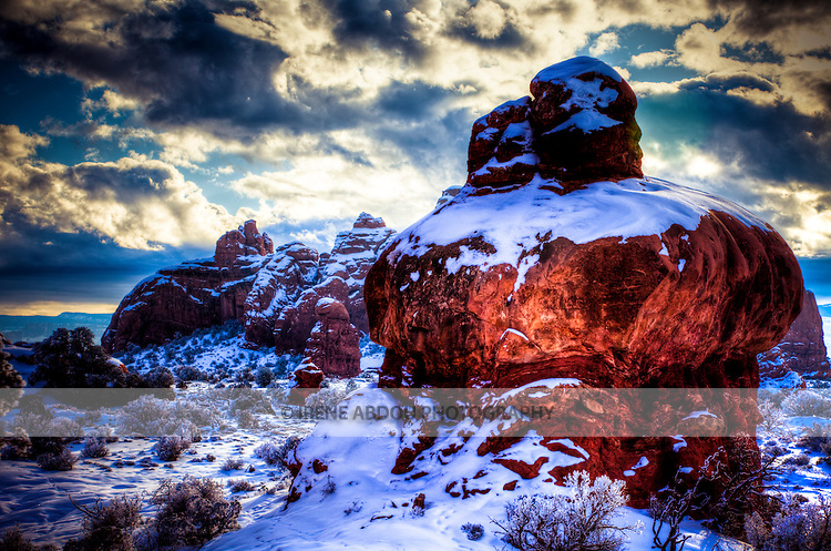 Fantastic rock formations and arches sculpted over thousands of years by wind, rain, and other forces of erosion dot the winter landscape of the Windows Section of Arches National Park in southern Utah.