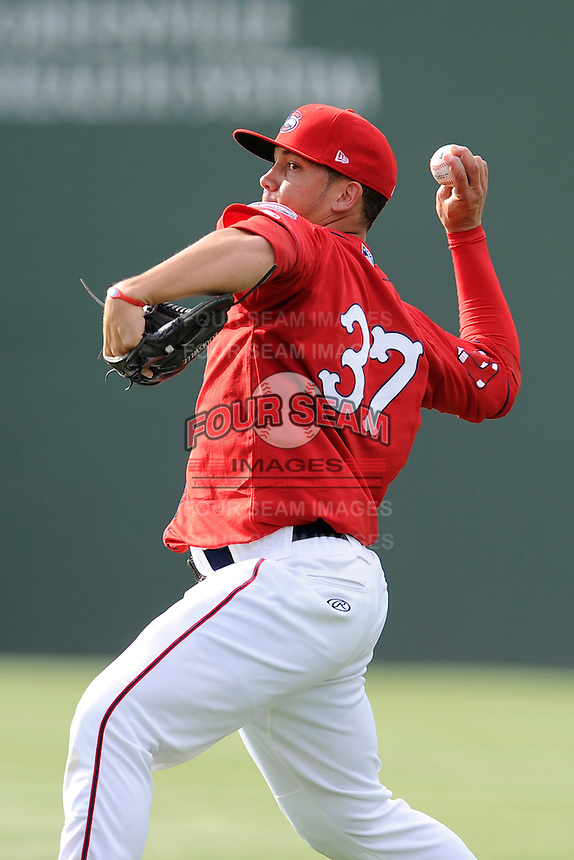Pitcher Jonathan Aro (37) of the Greenville Drive works on a pitcher fielding drill on the team's preseason workout on Wednesday, April 2, 2014, at Fluor Field at the West End in Greenville, South Carolina. (Tom Priddy/Four Seam Images)