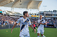 CARSON, CA - SEPTEMBER 29: Uriel Antuna #18 of the Los Angeles Galaxy scores his goal and celebrates during a game between Vancouver Whitecaps and Los Angeles Galaxy at Dignity Health Sports Park on September 29, 2019 in Carson, California.