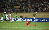 South Korea's Min Woo Kim (3) sits on the field stunned after a 3-2 defeat to Ghana during the FIFA Under 20 World Cup Quarter-final match at the Mubarak Stadium  in Suez, Egypt, on October 09, 2009.