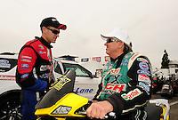 Nov. 10, 2011; Pomona, CA, USA; NHRA funny car driver Bob Tasca III (left) talks with John Force during qualifying at the Auto Club Finals at Auto Club Raceway at Pomona. Mandatory Credit: Mark J. Rebilas-.