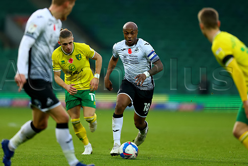 7th November 2020; Carrow Road, Norwich, Norfolk, England, English Football League Championship Football, Norwich versus Swansea City; André Ayew of Swansea City takes on Przemyslaw Placheta of Norwich City