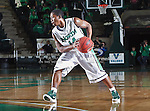 North Texas Mean Green guard Trey Norris (14) in action during the NCAA  basketball game between the St. Gregory Cavilers and the University of North Texas Mean Green at the North Texas Coliseum,the Super Pit, in Denton, Texas. UNT defeated St. Gregory's 81 to 52...