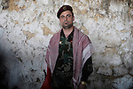 20/03/15 -- Akre, Iraq -- A man in military clothes in Akre