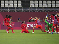KASHIMA, JAPAN - AUGUST 2: Jessie Fleming #17 of Canada celebrates with her team after scoring a goal during a game between Canada and USWNT at Kashima Soccer Stadium on August 2, 2021 in Kashima, Japan.