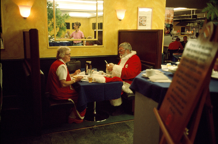 Photograph: John Angerson<br /> Denmark. Kobenhavn. Klampenborg. Every year more than 100 Santa Clauses from around the world get together to take part in the World Santa Claus Congress.