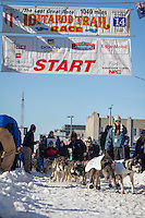 Katherine Keith and team leave the ceremonial start line at 4th Avenue and D street in downtown Anchorage during the 2014 Iditarod race.<br /> Photo by Jim R. Kohl/IditarodPhotos.com