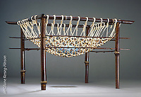 """Basket sculpture """"Honoring"""" by artist June Kerseg-Hinson incorporating bamboo,bead and stone elements"""