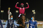 March 27, 2021: MISHRIFF (IRE) #7, ridden by jockey David Egan wins the Dubai Sheema Classic for trainer John and Thady Gosden on Dubai World Cup Day, Meydan Racecourse, Dubai, UAE. Shamela Hanley/Eclipse Sportswire/CSM