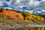 San Juan Autumn #2.  Looming above Trout Lake, and benefitting nicely from the remnants of a clearing storm, these peaks provide an exquisite backdrop for a large stand of orange aspens.<br /> <br /> Tech info: Nikon D850 camera with 28-300mm lens at 50mm, 1/500 sec. at f11, ISO 250<br /> <br /> Image ©2021 James D. Peterson