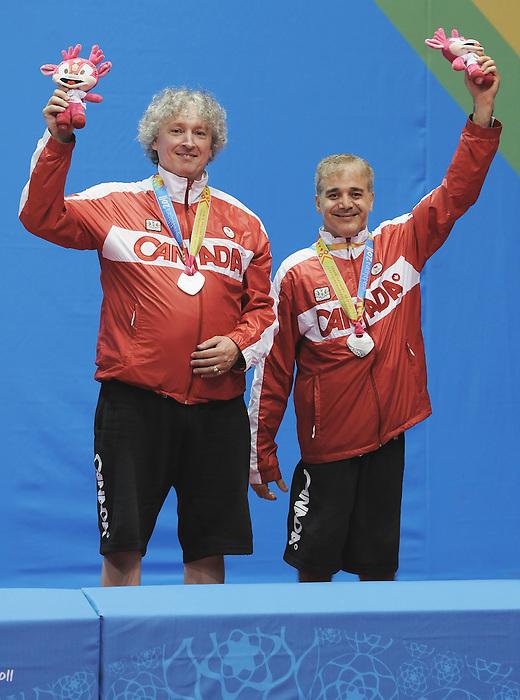 Masoud Mojtahed and Ian Kent, Guadalajara 2011 - Para Table Tennis // Paratennis de table.<br /> Masoud Mojtahed and Ian Kent receiving their Silver Medal for the Men's Team C 6-8 // Masoud Mojtahed et Ian Kent reçoivent leur médaille d'argent pour l'équipe masculine C 6-8. 11/18/2011.