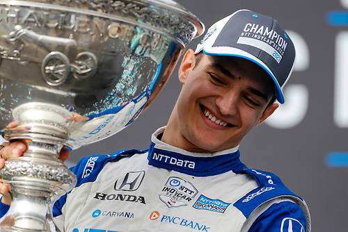 #10: Alex Palou, Chip Ganassi Racing Honda with the Astor Cup as he celebrates on the championship podium