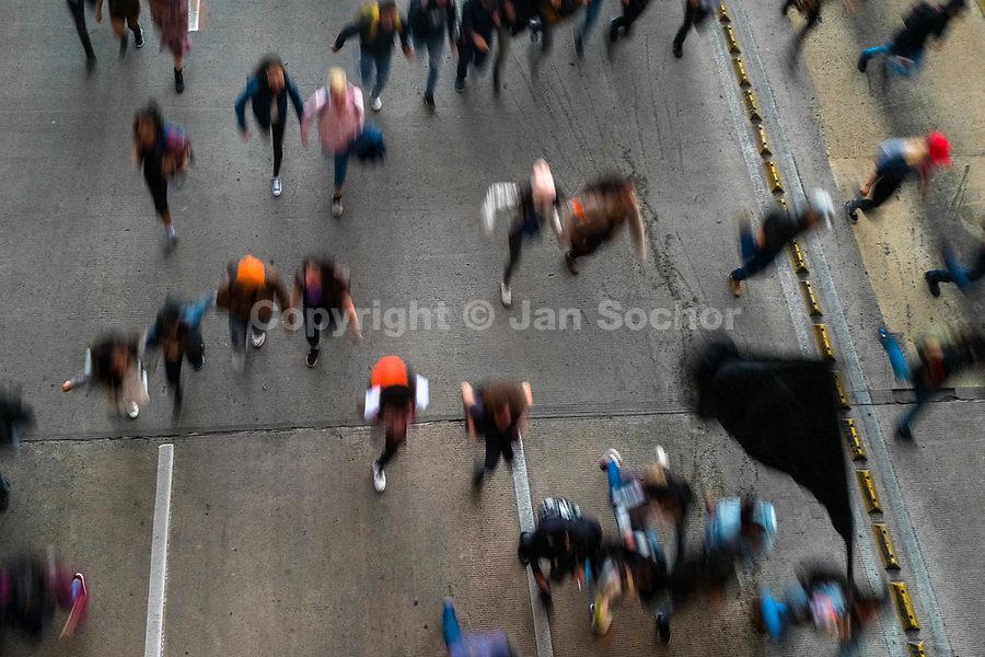 Students of the Universidad Nacional de Colombia run on the highway during a protest march against government's policies and corruption within the public educational system in Bogotá, Colombia, 24 October 2019.
