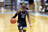 CHAPEL HILL, NC - FEBRUARY 24: Symir Torrence #10 of Marquette dribbles the ball during a game between Marquette and North Carolina at Dean E. Smith Center on February 24, 2021 in Chapel Hill, North Carolina.