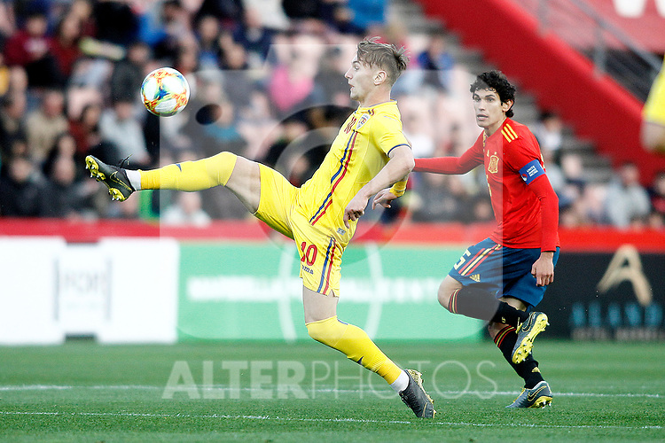 Romania's Dragu? Denis and Spain's Jesus Vallejo   during the International Friendly match on 21th March, 2019 in Granada, Spain. (ALTERPHOTOS/Alconada)