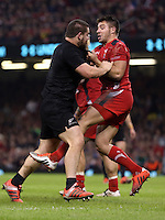 Pictured: A fight breaks out between Dane Coles (in black) of New Zealand and Wales players Saturday 22 November 2014<br />