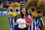 Sheffield Wednesday 2 Peterborough 1, 20/01/2010. Hillsborough, Championship. One of a group of display dancers is surprised by two giant Owl mascots before Sheffield Wednesday take on Peterborough United in a Coca-Cola Championship match at Hillsborough Stadium, Sheffield. The home side won by 2 goals to 1 giving Alan Irvine his third straight win since taking over as Wednesday's manager. Photo by Colin McPherson.