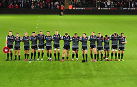 Ospreys players line up for a minutes silence during the Guinness Pro14 Round 8 match between the Ospreys and Glasgow Warriors at the Liberty Stadium in Swansea, Wales, UK. Friday 2nd November 2018